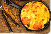 stock photo of scrambled eggs  - Skillet Peperoni and Spinach Egg Scramble on table - JPG