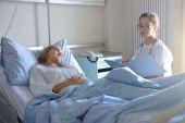 stock photo of hospital patient  - female doctor and a patient in hospital - JPG