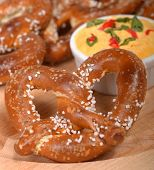 image of pretzels  - Delicious and rustic fresh German style pretzel served with a cheddar cheese spread - JPG