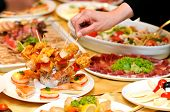 picture of catering  - Candid shot of human taking food party catering.