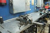 picture of workbench  - the image of a vice on a metal workbench - JPG