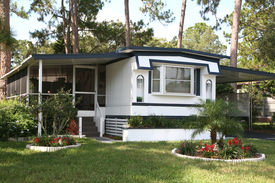 stock photo of screen-porch  - Pride of ownership shows in the lawn and garden in front of this older mobile home in a retirement community - JPG