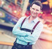 stock photo of lederhosen  - Handsome guy wearing Bavarian Lederhosen trousers with his arms folded - JPG