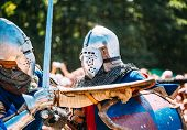 pic of knights  - Knights In A Fight With Swords - JPG