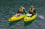 picture of kayak  - Happy Couple Kayaking on a lake together - JPG