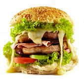 stock photo of cheese-steak  - Homemade steak burger with pork chops bacon vegetable mix and melted cheddar cheese - JPG