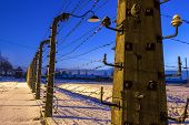 picture of nazi  - Fence around nazi concentration camp of Auschwitz Birkenau Poland