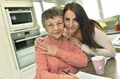 foto of granddaughter  - Portrait of elderly woman with granddaughter at home - JPG