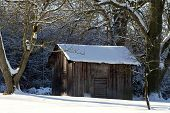 stock photo of wooden shack  - Landscape with wooden shack in the snow - JPG