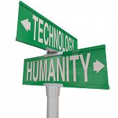 picture of intersection  - Intersection of Technology and Humanity illustrated on two green street or road signs pointing in opposite directions - JPG