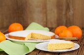pic of clementine-orange  - Cut clementine pie with clementines on wooden background horizontal - JPG