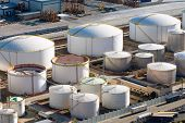 picture of tank truck  - Big gas storage tanks seen in a harbour - JPG