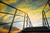 stock photo of stairway to heaven  - Stairway with colourful sky at sunset - JPG