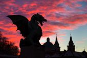 picture of fairy tail  - Vivid sunset sky over silhouette of Famous Dragon bridge, symbol of Ljubljana, capital of Slovenia, Europe.