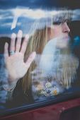stock photo of car-window  - young woman portrait in the car behind the window - JPG