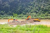 stock photo of monster-truck  - Monster machines working on site at Thailand - JPG