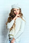 image of beret  - Cute teenager girl with beautiful long curly hair wears white knitted jersey and beret - JPG