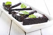 stock photo of lenten  - Slice of chocolate cake with glazeon tray - JPG