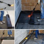 stock photo of overhauling  - Preparing part of bitumen roofing felt roll for melting by gas heater torch flame - JPG