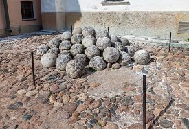 picture of cannon-ball  - Pile of old stone cannon balls in Novgorod kremlin Russia - JPG