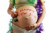 foto of tawdry  - Closeup of Pregnant woman belly with HAPPY NEW YEAR - JPG