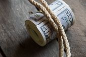 picture of fifties  - American Fifty Dollar Bills rolled up on wooden  - JPG