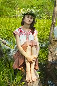 stock photo of undine  - girl in russian traditional clothes at lake - JPG