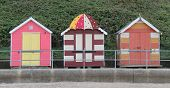 picture of beach hut  - A Contrast of Three Different Wooden Beach Huts - JPG