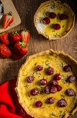 picture of tarts  - Lemon tart with rosemary and berries filled with cream topped berries - JPG