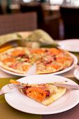 stock photo of tourist-spot  - Authentic pizza with tomatoes smoked sausage bacon and parsley - JPG