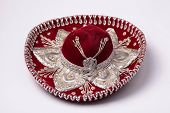 foto of sombrero  - Red mexican sombrero with silver galloon on white background - JPG