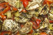 stock photo of leek  - Vegetables mix baked in the oven with aubergine, red bell pepper, leek, basil and olive oil.