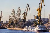 stock photo of barge  - barges and cranes in the river port  - JPG