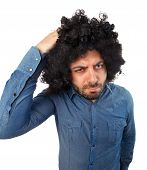 pic of lice  - Funny man with the wig while scratching head on white background - JPG