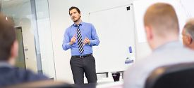picture of gesture  - Business man making a presentation at office - JPG