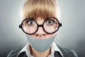 picture of freedom speech  - Scared woman with mouth taped shut - JPG
