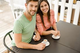 pic of youg  - Youg couple at the local coffee shop drinking a coffee - JPG