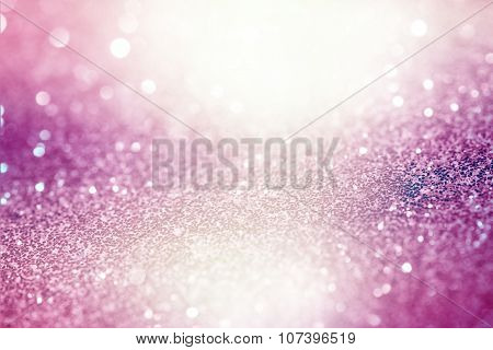 Pink Festive Christmas abstract bokeh background, shining lights, holiday sparkling atmosphere, cele