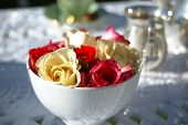 Fresh Roses In A White Round Bowl For Teatime Table Setting poster