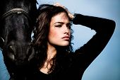 stock photo of black horse  - beautiful black hair woman and black horse outdoor day shot - JPG