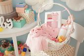Wicker basket with gifts for baby shower indoors poster