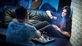 Beautiful Young Woman Play Game Of Chess poster