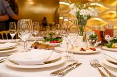 Sparkling Glassware Stands On Round Table Prepared For Wedding Dinner In Restaurant. Table Setting, poster