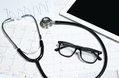 Medical Stethoscope And Tablet Display With Cardiogram Chart. poster