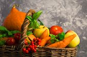 Different Fruits And Vegetables In Wicker Basket On Grey Background poster