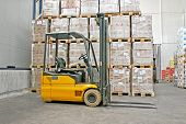 foto of delivery-truck  - Yellow fork lifter truck and cargo boxes - JPG