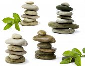 picture of flower-arrangement  - balanced spa stones with green plant isolated on white background - JPG