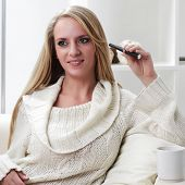 stock photo of e-cigarettes  - beauty girl indoors with e - JPG