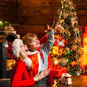 Mother And Little Child Boy Adorable Friendly Family Having Fun. Family Having Fun At Home Christmas poster