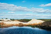 Industrial Sand Quarry With Artificial Reservoir. Sand Pit. Construction Industry. Sand Hills Agains poster